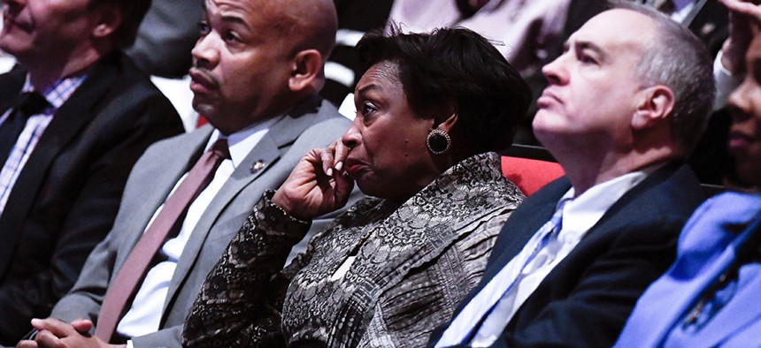 State Comptroller Thomas DiNapoli (right) listens to Gov. Andrew Cuomo's State of the State address alongside Senate Majority Leader Andrea Stewart-Cousins and Assembly Speaker Carl Heastie.