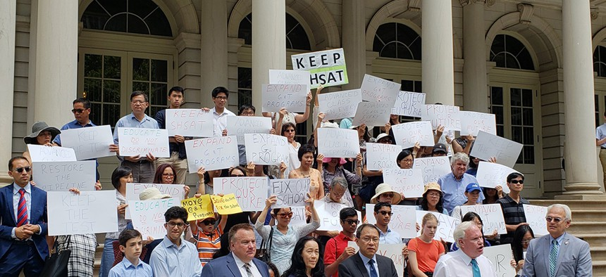 State Senator Tony Avella, New York City Councilman Bob Holden and the Chinese American Citizens Alliance hold a rally on the steps of City Hall to promote legislation to keep the SHSAT placement test in place.