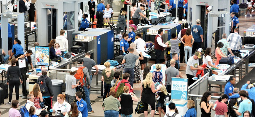 Travelers going through airport security.