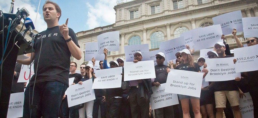 Josh Mohrer, then Uber's New York manager, led a rally in front of City Hall in 2015 while the council considered a cap on for-hire vehicles.