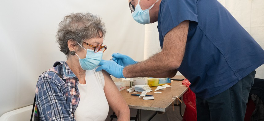 A woman gets vaccinated at Calvary Baptist Church in White Plains.