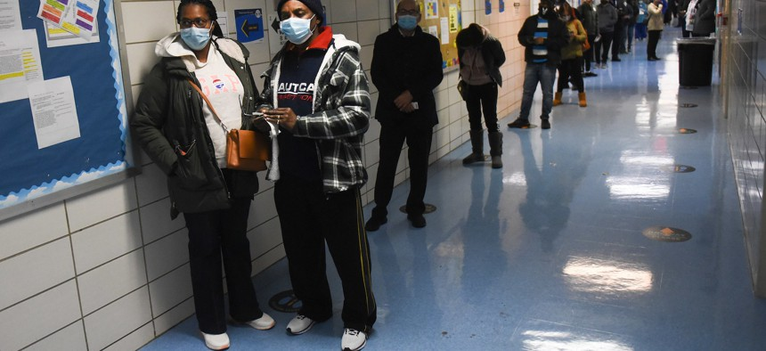 New Yorkers line up at a polling site in South Ozone Park in Queens.
