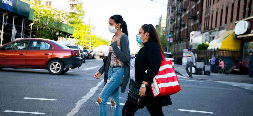 A woman and her daughter walking in the Washington Heights neighborhood in Manhattan.