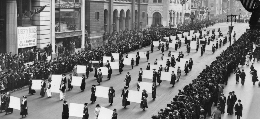 Suffragists march down Fifth Avenue in October 1917, displaying placards containing the signatures of more than 1 million New York women demanding the right to vote.