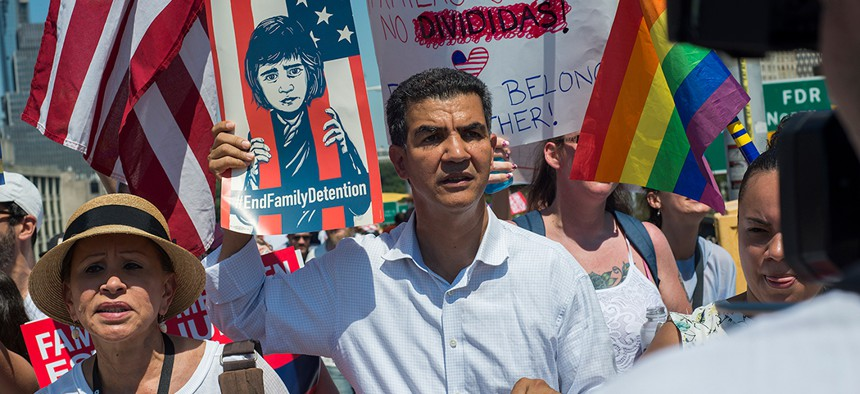 New York City Councilman Ydanis Rodriguez [center] and Rep. Nydia Velazquez [left] take part in the Families Belong Together March in New York City.