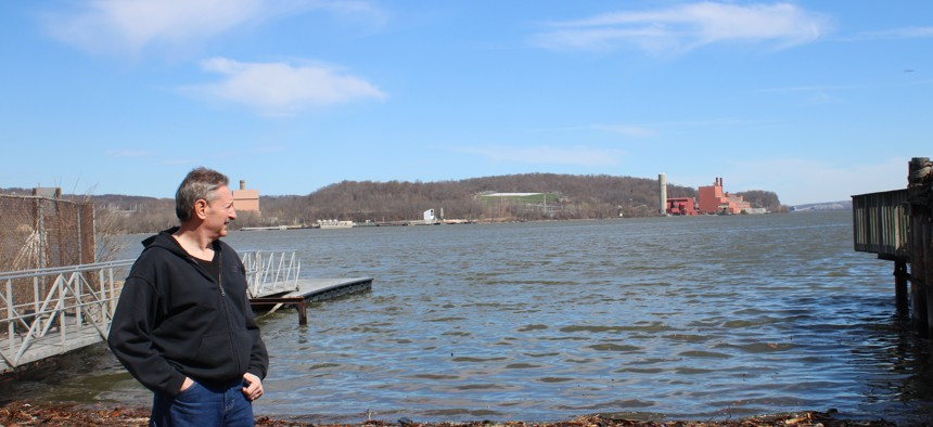 Lou Cicigline, a retired state corrections sergeant, surveys Danskammer from across the Hudson, near his home in the hamlet of Chelsea.