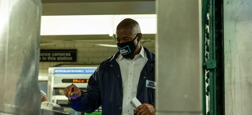 Eric Adams riding the subway on May 18.