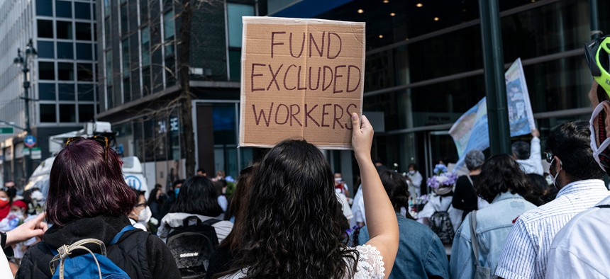 Advocates attend an excluded workers rally on April 4.