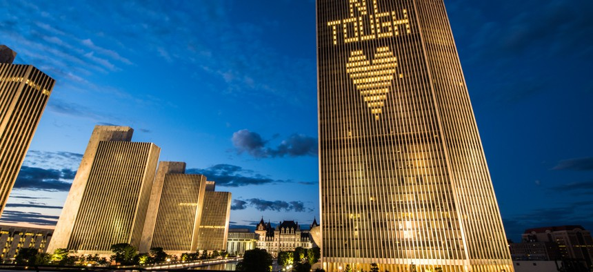 """Buildings in Albany lit up with the words """"NY Tough"""""""