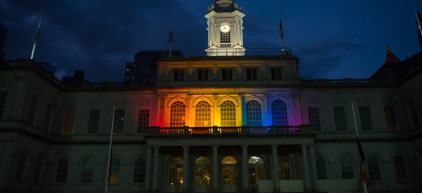 New York City Hall lit up for pride.