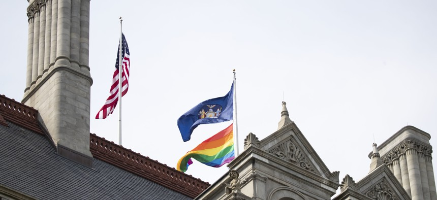 Pride flag flying over the state capitol in Albany.