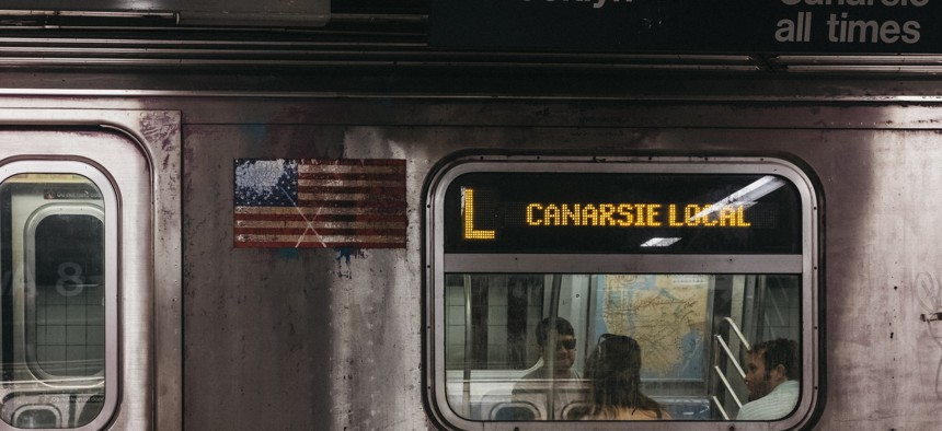 Canarsie local subway L train stops at a station