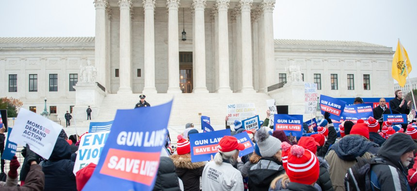 A December 2019 protest against weakening gun laws held outside the Supreme Court.