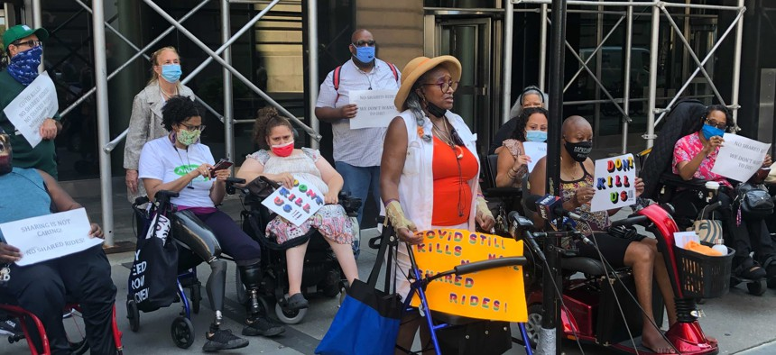 Paratransit users and advocates for people with disabilities rally outside the MTA's headquarters to end shared trips on Access-A-Ride.