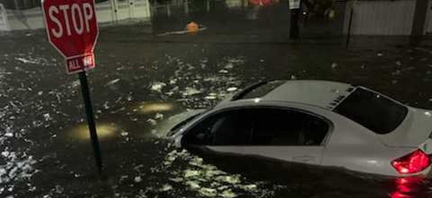 A car that was underwater in Jamaica due to the severe flooding on Wednesday.