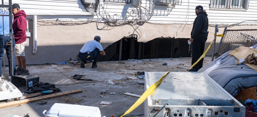 NY Department of Buildings staff inspects the house where people were killed when their basement apartment was flooded during Hurricane Ida.