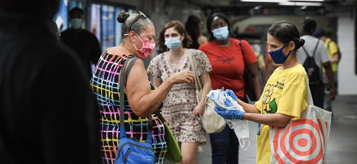 Volunteer handing out masks at the Atlantic Av. - Barclay's Center stop.