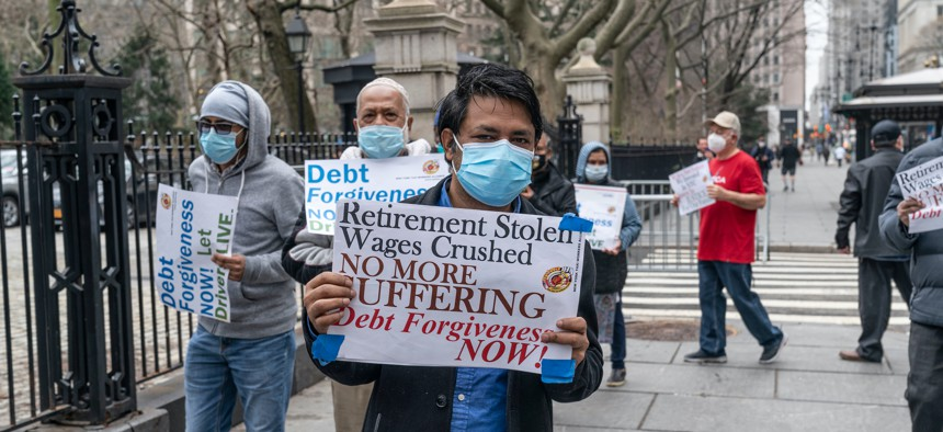 Yellow taxi drivers and medallion owners rally for debt forgiveness at the gates of City Hall
