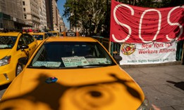 Taxis parked in protest at New York City Hall.